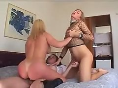 Girl fucked by two shemales on bed