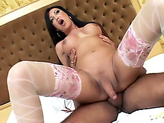 Stunning shemale model Pamela slurping a cock before taking it in her rear live