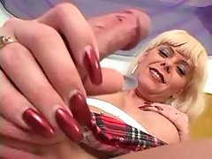 Blond TS plays with cock and jizzes