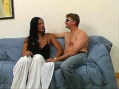 Ethnic shemales seduce man on sofa