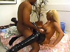 Black stud fucks shemale in boots