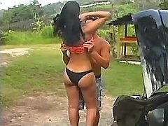 TS and guy suck each other outdoor